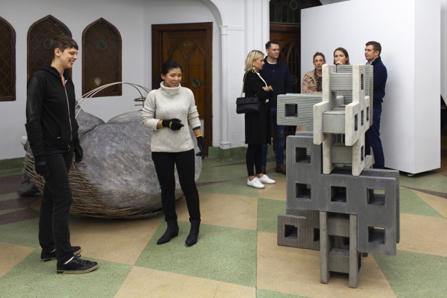 Exhibition visitors playing with cement blocks